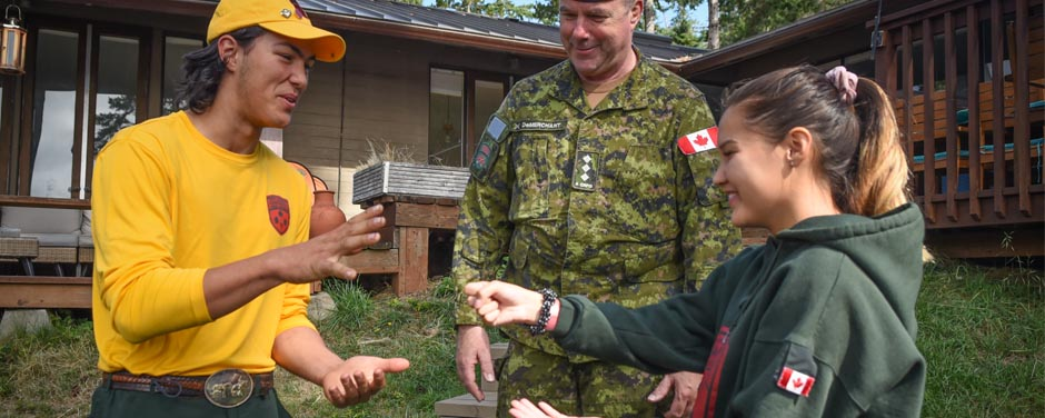 Slide - Junior Canadian Ranger (JCR) Robert Gienger (left)  takes part in a teambuilding activity